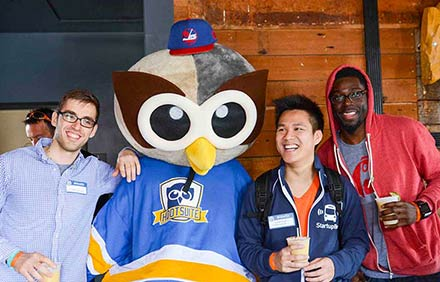 Hootsuite's Owly mascot hanging out with some adoring fans